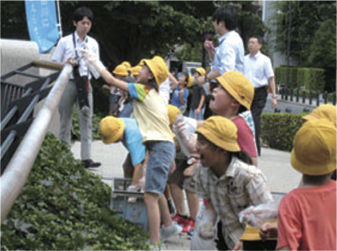 Aiai Bridge: Fujimidai Elementary School children are throwing EM Bokashi fermented Mudballs in the stream of the river