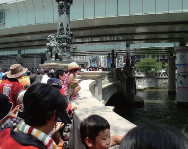 "The Historic Bridge ""Nihonbashi"" Preservation Society. Throwing EM Mudballs into the river at the annual ""Nihonbashi"" cleanup event."